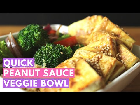 The ultimate veggie bowl: quinoa, crispy tofu, vegetable stir fry and peanut sauce