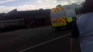 Fife police transit van on blues past the police station