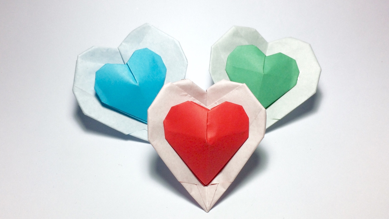 paper origami heart Origami flying heart step 1: start with a 6 inch x 6 inch (15cm x 15cm) square origami paper, color side down fold paper in half but only make a small crease in the center.