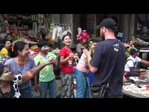 Giving Flowers to women in Myanmar