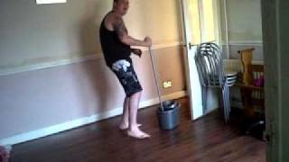 migael washing the floor&dancing. Thumbnail