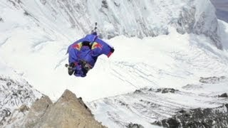 Mount Everest Wingsuit Jump Video: Man Jumps Off Peak With Wingsuit(Russian Valery Rozov, 48, leaps off the world's highest peak. For more GMA, click here: http://gma.yahoo.com/, 2013-05-29T14:44:00.000Z)