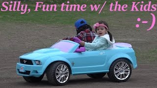 Brother & Sister Driving a Ford Mustang Ride-On Power Wheels Off Road