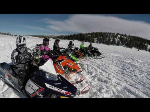 Snowy Mountain Range Snowmobiling