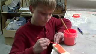 Tom Cooper paints pinewood derby car Reeds Spring MO 1/24/09