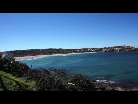 Bondi Beach - Sydney/Eastern Suburbs, NSW Australia - South view with surfers in the water