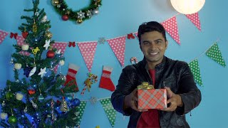 A handsome young man wishing 'Merry Christmas' with a beautiful Christmas present