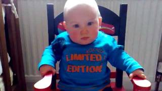 11 Month Old Baby Rocking Himself On Rocking Chair
