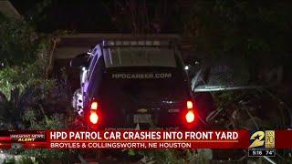 HPD patrol car crashes into front yard