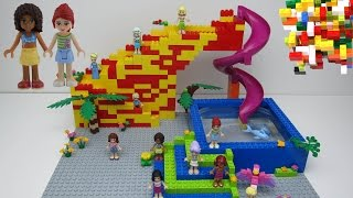 Lego Friends 2 + slide + dolphin + swimming pool + Mia + Olivia + Emma + Andrea +Stephanie 2!