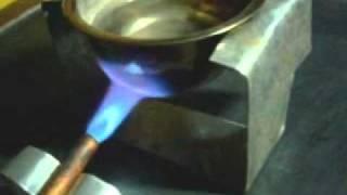 Mencoba  kompor gas dengan uap bensin