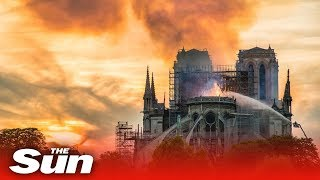 Notre Dame fire: spire collapses as inferno rages below