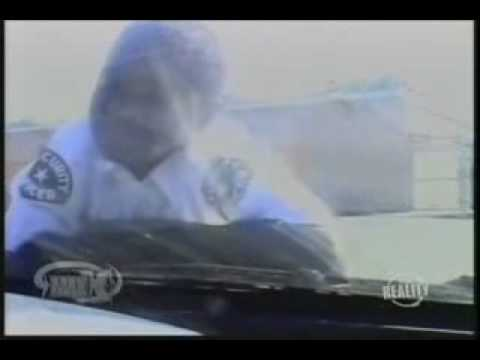 Gary Coleman jumps on a car working as a security guard