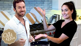 chef-brie-artem-tag-team-cooking-in-the-kitchen
