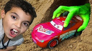 sami play at the beach with cars in the sand