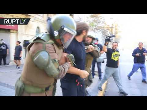 Violent clashes erupt in Chile as march against 'sexist education'
