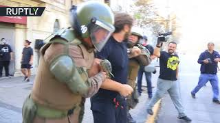 Violent clashes erupt in Chile at march against 'sexist education'