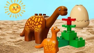 LEGO Duplo dinosaur & toy cars. Kids' video.