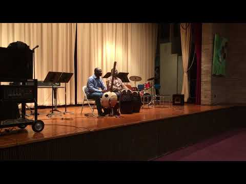 Ben Ayettey and Yacouba Sissoko Perform at Holmes Stem Academy in Flint.
