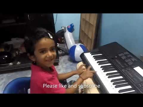 play piano for janaganamana (Indian National anthem) song by a cute and little girl