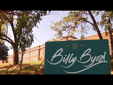 Ribbon cutting for new apartment complex at historic William Byrd High School