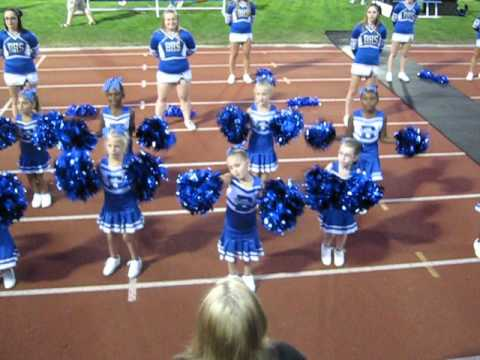 Little Cheerleaders Cheerleading at a Varsity football game