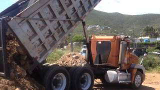 Freightliner Dump Truck Dumping Dirt