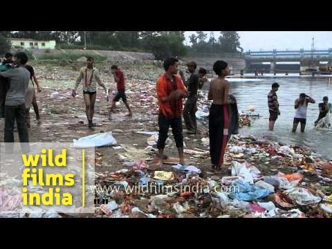 Polluted bank of river Yamuna with plastic waste