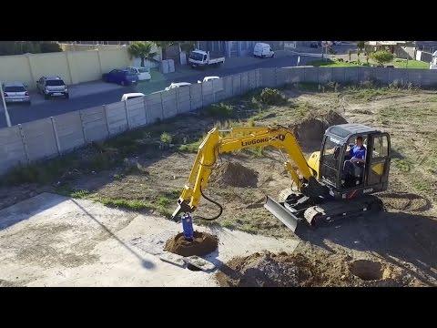 Earth Drill 7000MAX Drilling Through Concrete Foundations
