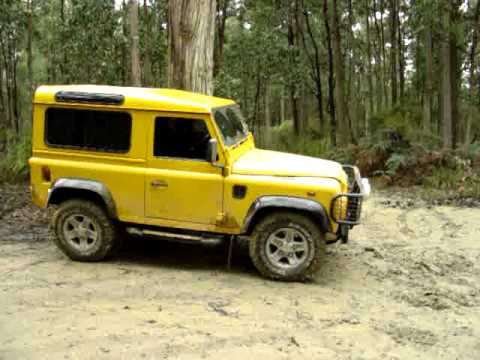 Land Rover Yellow Defender 90 in mud - YouTube