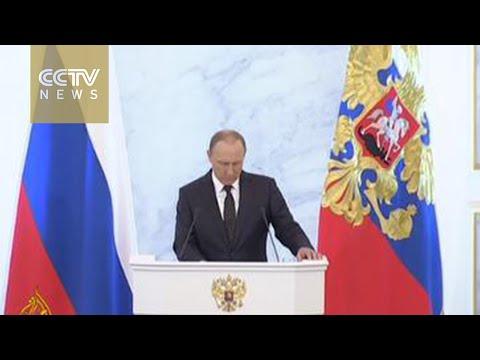 """Putin: Turkey """"will regret"""" shooting down Russian jet"""