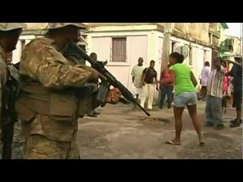 Belize's Prime Minister Dean Barrow  behaving like a Gangster, his  Bitch Marco Vidal slaughter 4