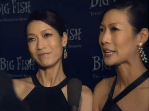 Twins Arlene & Ada Tai and others are ed at the Big Fish Premiere