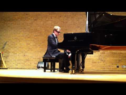 derek paravicini playing at autism concert