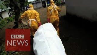 Ebola body collector faces threats and violence - BBC News
