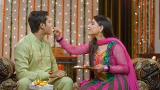 Young brother and sister eating sweets and celebrating Raksha Bandhan festival