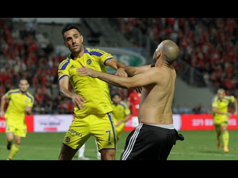 Fight between football player and a football fan in the derby of Tel Aviv