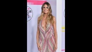 Heidi Klum, 44, exposes eye-popping assets in dress slashed to navel thumbnail