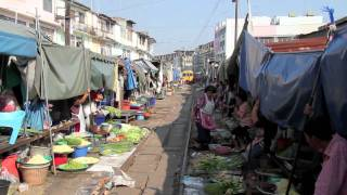 Train runs through Market in Thailand