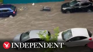 London roads underwater after torrential rain causes flooding