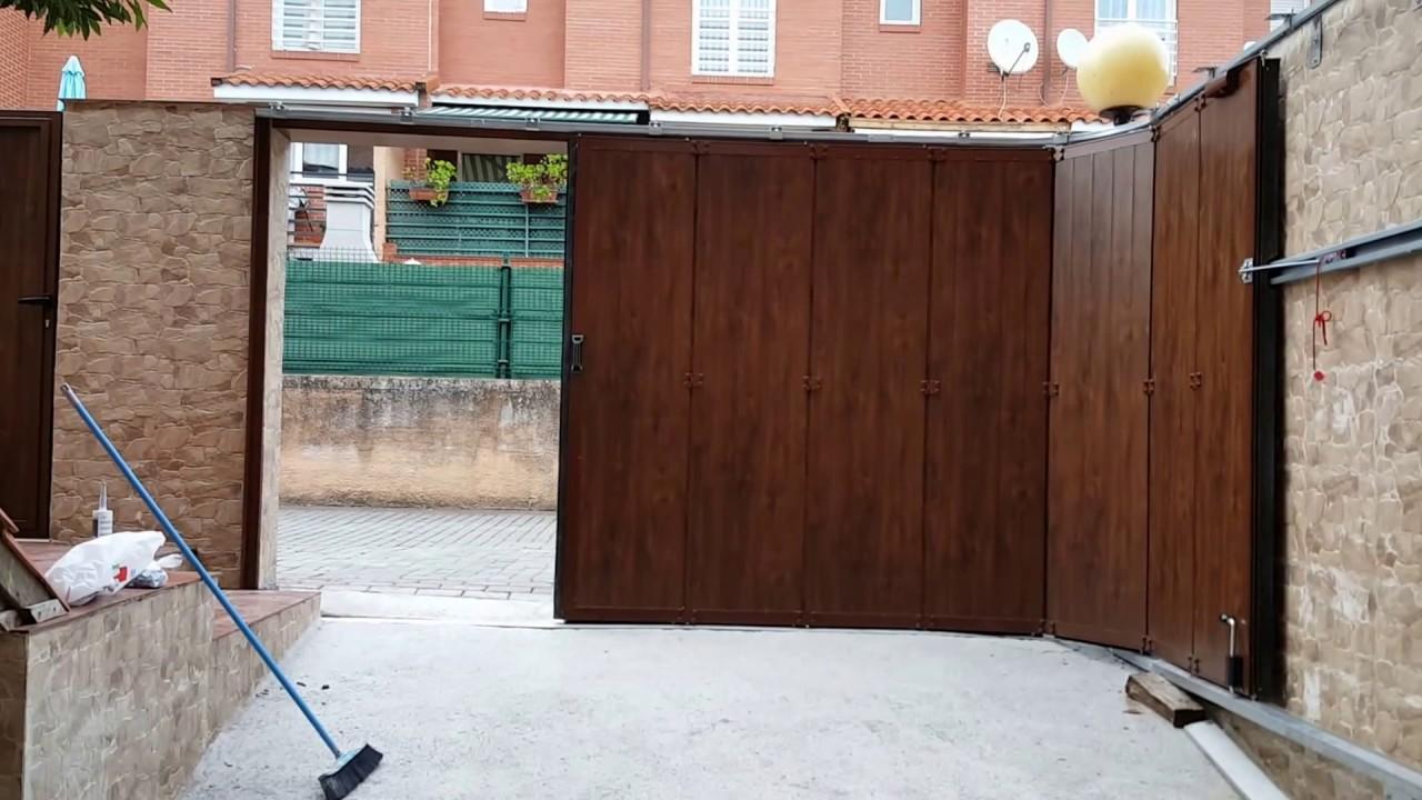 Puerta seccional de apertura lateral www - Puertas de garages ...