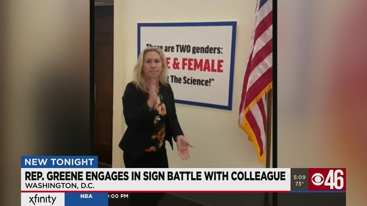 Marjorie Taylor Greene posts anti-transgender sign across hall from ...