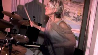 Mother of the Bride playing drums
