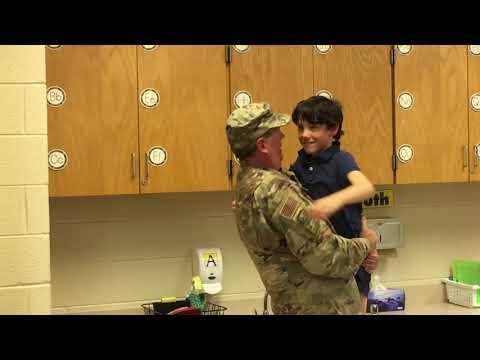 Navy reservist surprises his son at Arlington Science Focus School