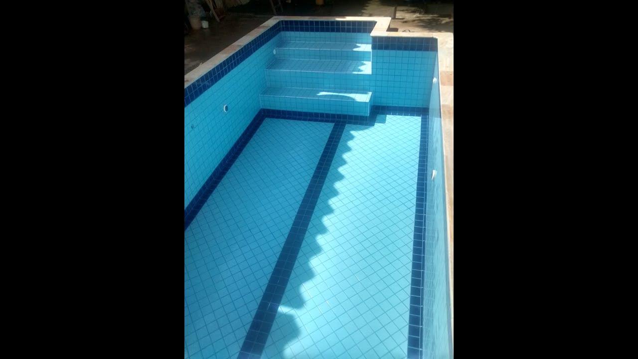 Reforma transforma o de piscina de vinil para azulejo for Piscinas merino