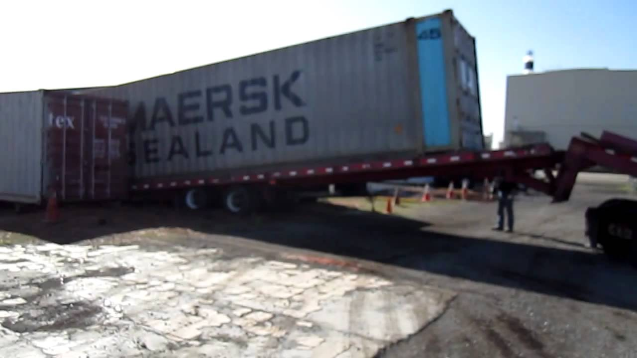 SpaceSpots.com Moving a LOADED Shipping Container - YouTube