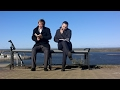 Two Men Sitting Outdoors On a Bench With a Book | Stock Footage - Videohive