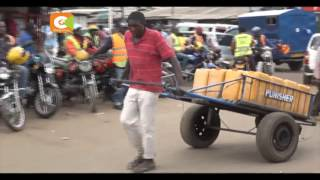 Varsity student pushes handcart to raise fees