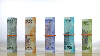 Racking focus shot of different and new Indian paper currency - white background
