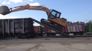 Excavator climbs into railcar